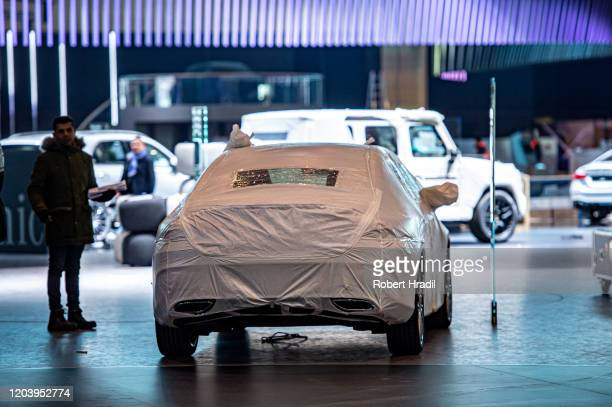 Exhibitors have to dismantle their displays after cancellation of the Geneva Auto Show on February 28, 2020 in Geneva, Switzerland. Swiss authorities...
