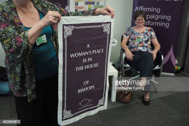 Exhibitors in support of women bishops sell tea towels to delegates during the annual Church of England General Synod at York University on July 13...