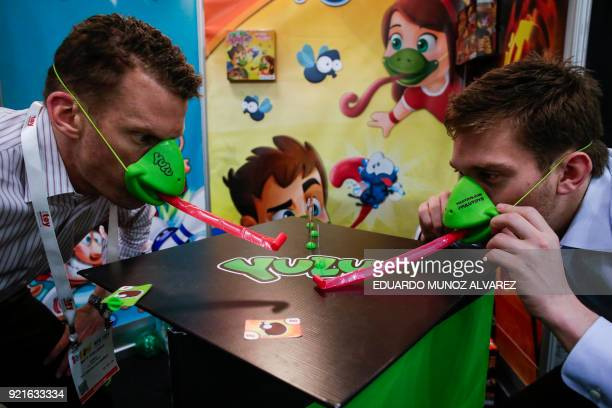 Exhibitors play 'Tic Tac Tongue' from Yulu Toys during the annual New York Toy Fair at the Jacob K Javits Convention Center on February 20 in New...