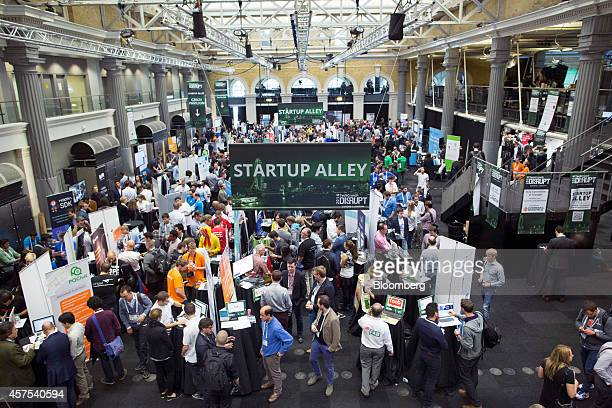 Exhibitors promote their business startup companies in the main hall titled 'Startup Alley' at the Disrupt Europe 2014 conference in London UK on...