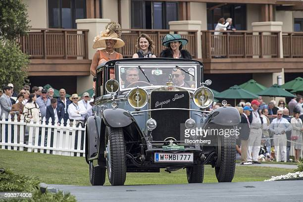 Exhibitors ride in a 1922 Hispano Suiza H6B Chapron Splendid Landaulet motor vehicle during the 2016 Pebble Beach Concours d'Elegance in Pebble Beach...