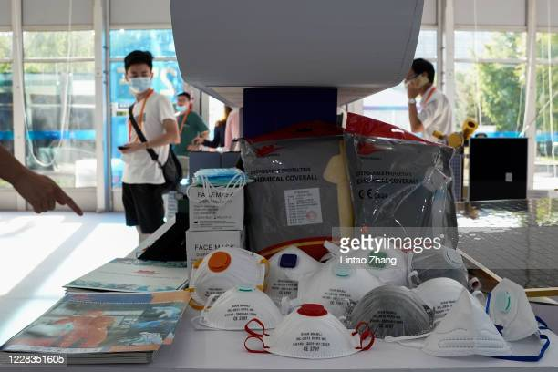 Exhibitors show protective masks during the 2020 China International Fair for Trade in Services at Beijing Olympic Park on September 5, 2020 in...