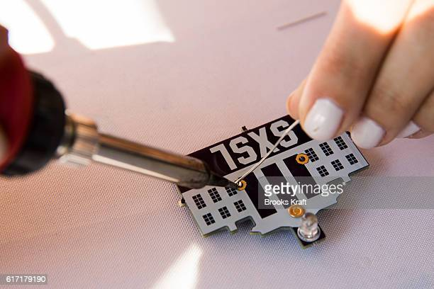 Exhibitors work on electronics at the 'South By South Lawn' SXSL festival on October 3 2016 in Washington DC The White House Festival is billed to...