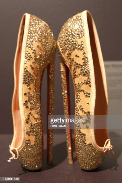 Exhibits on display during a preview of an exhibition celebrating 20 years of designs by French shoe designer Christian Louboutin at the Design...