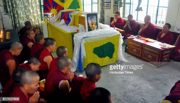 Exile Tibetan Buddhist monks and nuns pray for peace to the soul of Tenzin Choeying a 19yearold is brought to the north Indian hill town Dharamsala...