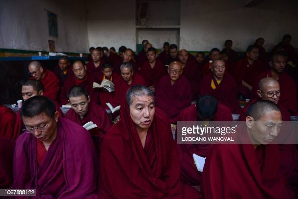 Exile Tibetan Buddhist monks pray during a cremation ceremony of Tibetan freedom fighter Palden Gyatso in McLeod Ganj a suburb of Dharamshala on...