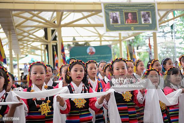 Exile Tibetan children sing to mark the Dalai Lama's 81st birthday in McLeod Ganj on July 6 2016 / AFP / Lobsang Wangyal