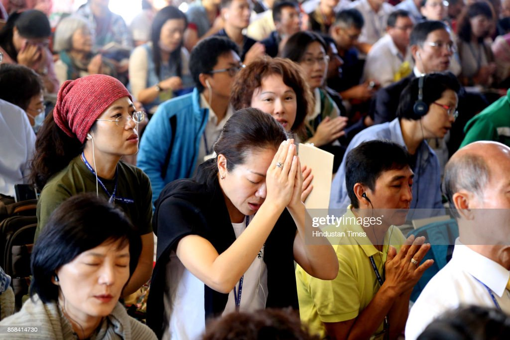 Exile Tibetans and foreigners listen to a spiritual speech of his spiritual leader, Dalai Lama (Not seen in the picture) on October 7, 2017 in Dharamsala, India.