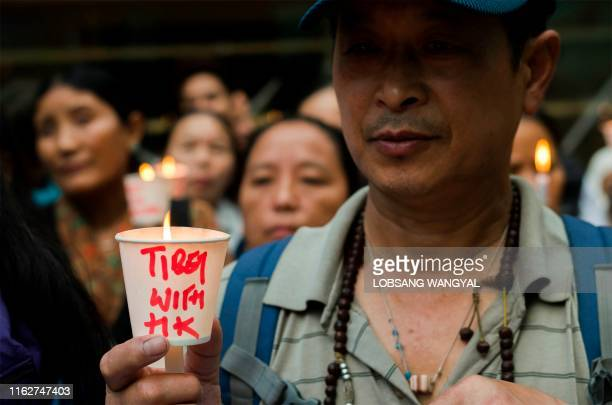 TOPSHOT Exile Tibetans march in a candlelight vigil to stand in solidarity with the protesters in Hong Kong in McLeod Ganj on August 19 2019