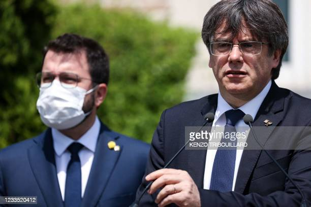 Exiled former Catalan leader and member of European Parliament Carles Puigdemont speak during a press conference with newly appointed Catalan...