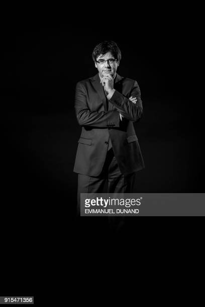 Exiled former Catalan leader Carles Puigdemont poses during a photo session in Brussels on February 7 2018 / AFP PHOTO / Emmanuel DUNAND