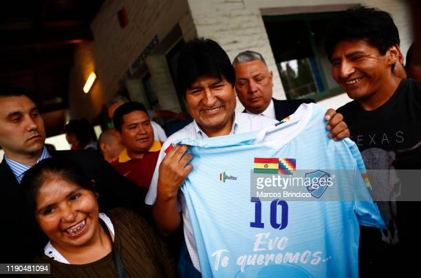 Exiled former President of Bolivia Evo Morales holds a jersey of the Bolivian soccer team Bolivar which reads Evo We love you during a Christmas...
