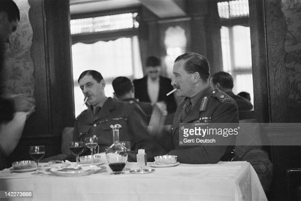 Exiled FreeFrench leader General Charles de Gaulle dining with British liaison officer MajorGeneral Sir Edward Spears London September 1940 The pair...