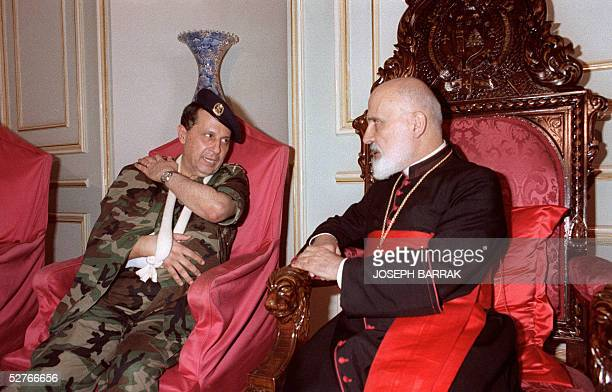 Exiled Lebanese opposition leader general Michel Aoun confers 21 September 1988 in Bkerkeh north of Beirut with Lebanese Maronite Patriarch Nasrallah...