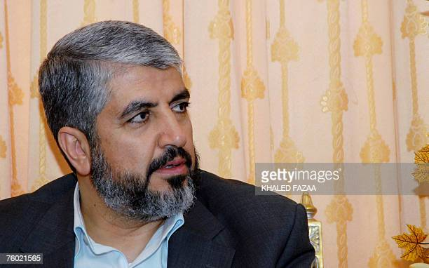 Exiled Palestinian Hamas supremo Khaled Meshaal listens to Yemeni Foreign Minister Abu Bakr Abdullah alKurbi during their meeting in Sanaa 08 August...