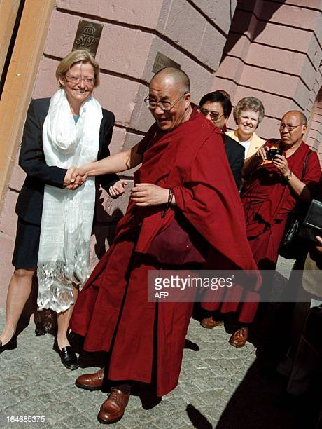 Exiled spiritual leader of Tibet the Dalai Lama is welcomed by Sweden's Foreign Minister Anna Lindh to Stockholm on 16 May 2000 The Dalai Lama is in...