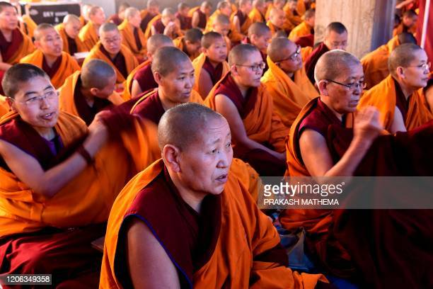 Exiled Tibetan Buddhist nuns pray at Choeling Monastery in Kathmandu on March 10 a date that marks the 61st anniversary of the Tibetan Uprising Day...