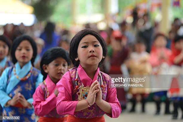 Exiled Tibetan children perform in celebration of the Dalai Lama's 80th birthday at Tsuglakhang temple in McLeod Ganj on July 6 2015 Thousands of...