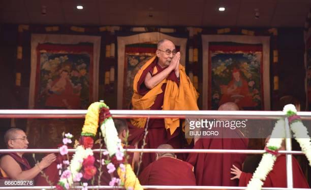Exiled Tibetan spiritual leader the Dalai Lama greets his Buddhist followers at the Yiga Choezin ground in Tawang District near the IndiaChina border...