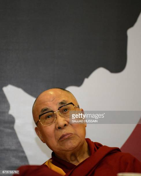 Exiled Tibetan spiritual leader the Dalai Lama looks on before he speaks on Compassion and Global Responsibility at a function in New Delhi on April...
