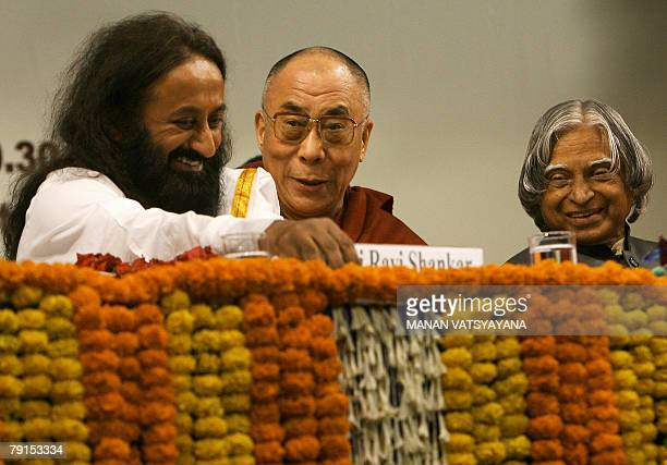 Exiled Tibetan spiritual leader the Dalai Lama shares a light moment with former Indian President APJ Abdul Kalam and founder of the Art of Living...