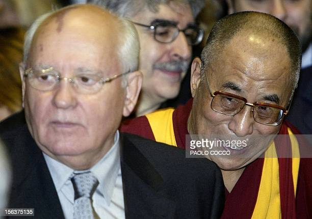 Exiled Tibetan spiritual leader the Dalai Lama smiles flanked by former President of Soviet Union and nobel peace laureate in 1990 Mikhail Gorbachev...