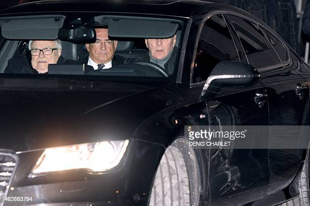 ExIMF chief Dominique StraussKahn and his lawyer Henri Leclerc ride in a car as they leave the Lille courthouse northern France on February 2 2015...
