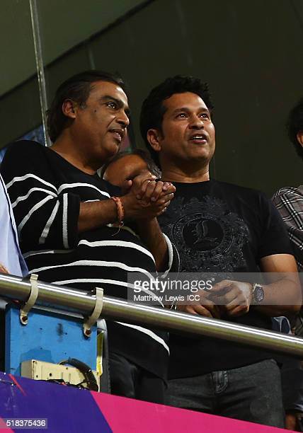 ExIndian cricketer Sachin Tendulkar watches from the stands with Indian businessman Mukesh Ambani during the ICC World Twenty20 India 2016 SemiFinal...
