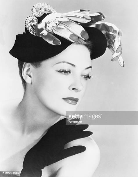 Existentialist milliner Jean Barthet of Paris created this hat symbolizing the hovering hands of fate Two rose satin hands wearing a voluminous...
