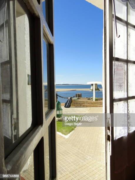 exit door at a lighthouse in jose ignacio, uruguay - jose ignacio lighthouse stock photos and pictures