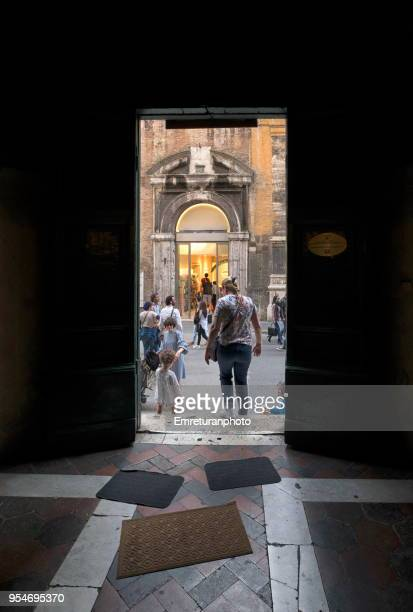 exit door of a church building with mops and people and a beggar in the street - emreturanphoto stock pictures, royalty-free photos & images