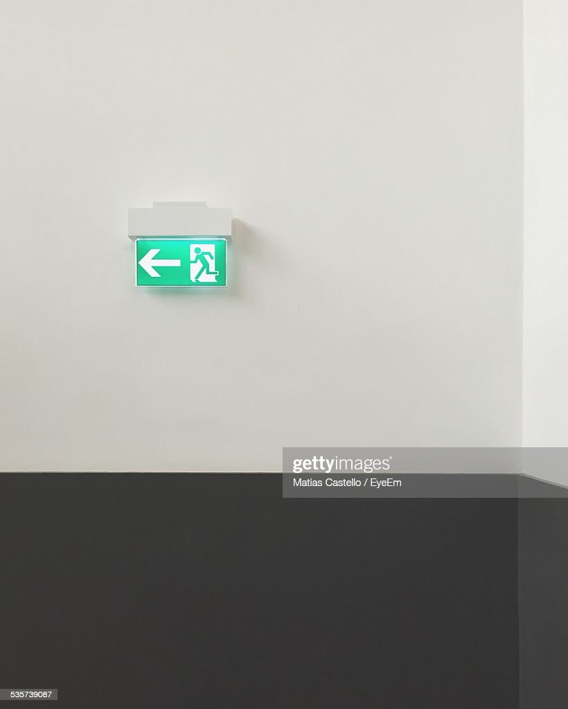 Exit sign and arrow symbol on wall stock photo getty images exit sign and arrow symbol on wall buycottarizona Images