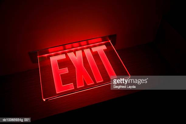 exit sign illuminated, close-up, low angle view - exit sign stock pictures, royalty-free photos & images