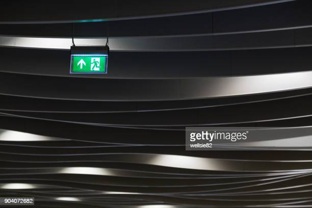 exit sign in birmingham new street station - curved arrows stock photos and pictures