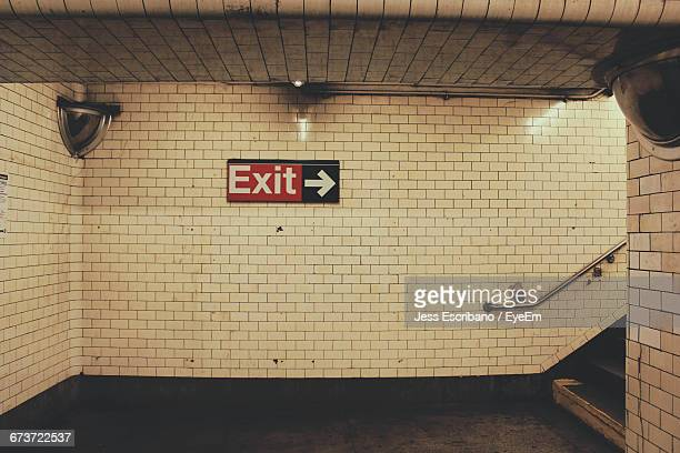 exit sign on tile wall in subway station - exit sign stock pictures, royalty-free photos & images