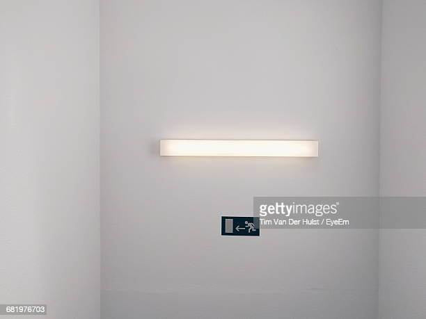 Exit Sign On White Wall