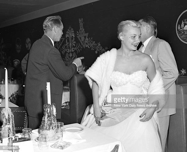 Exit Smiling Movie star Franchot Tone and his hardwon bride Barbara Payton leave table in Little Gypsy restaurant on W45 St after having their...