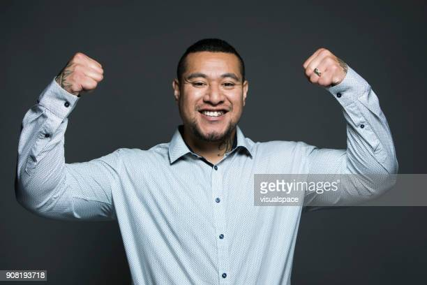 exited man - flexing muscles stock pictures, royalty-free photos & images