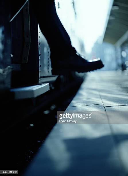exiting a train - 人の足 ストックフォトと画像