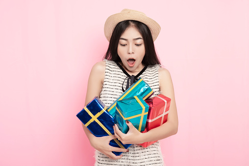Exiting woman holding a lot of gift box with happiness. - gettyimageskorea