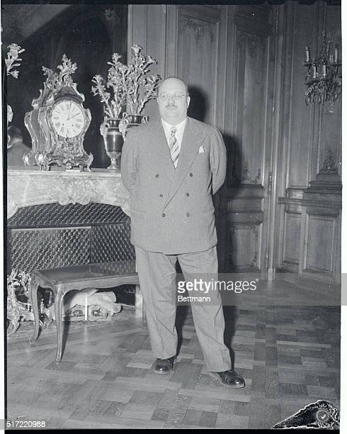 ExKing Farouk of Egypt poses in his hotel suite after his arrival in Paris from the Riviera The dethroned monarch is in exile
