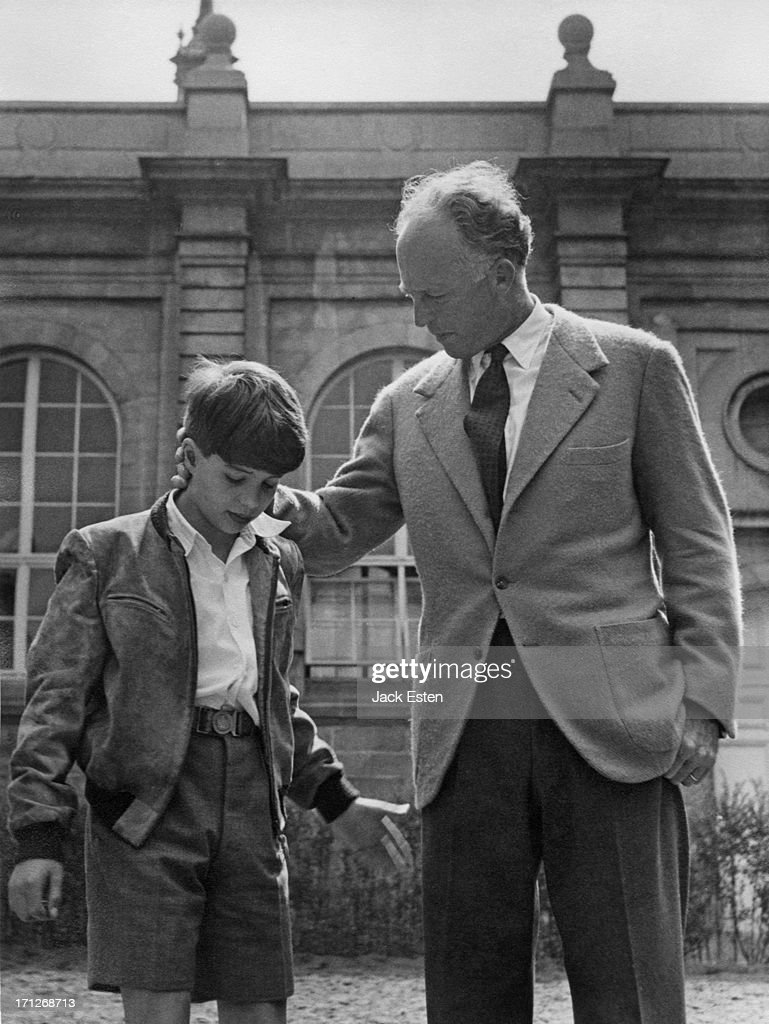 Ex-King Leopold III of Belgium (1901 - 1983) poses for a photograph with his youngest son, Prince Alexander of Belgium (1942 - 2009), at the Royal Palace of Laeken, Brussels, circa 1954.