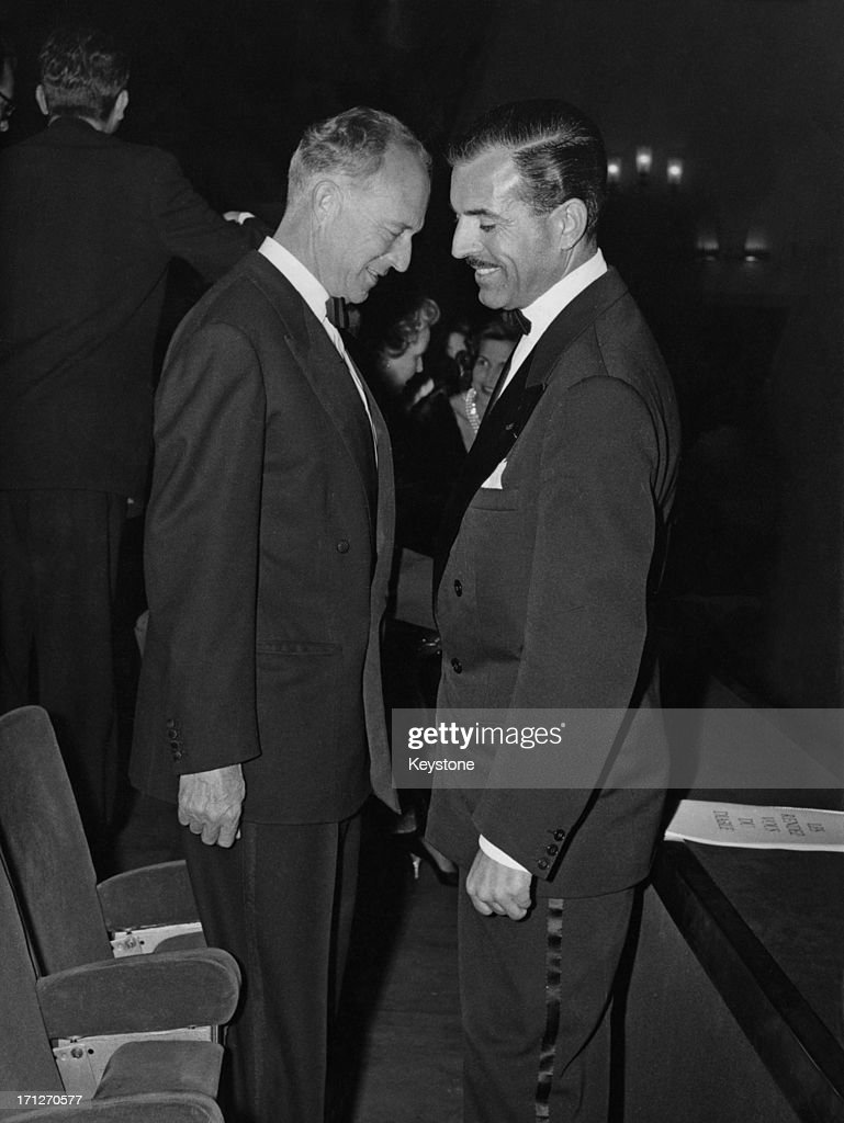 Ex-King Leopold III of Belgium (1901 - 1983) talks with Maurice Herzog (1919 - 2012), French High Commissioner for Youth and Sport, after the screening of the film 'Les Rendez Vous Du Diable' at the 'Normandie' cinema, Paris, France, 15th January 1959.