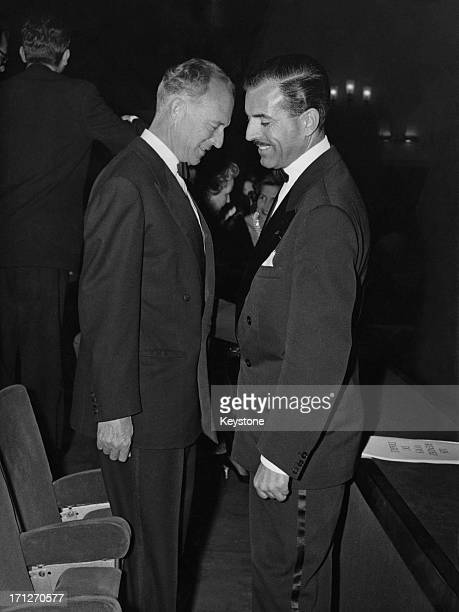 ExKing Leopold III of Belgium talks with Maurice Herzog French High Commissioner for Youth and Sport after the screening of the film 'Les Rendez Vous...