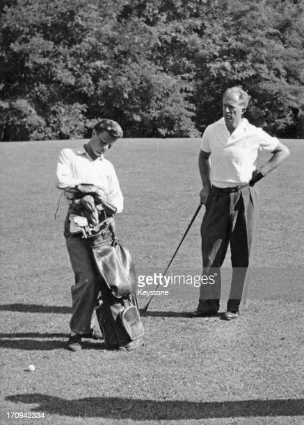 ExKing Leopold III of Belgium with his caddy seen here playing for Belgium at the Amateur International Golf Championship at Villa D'Este Lake Como...