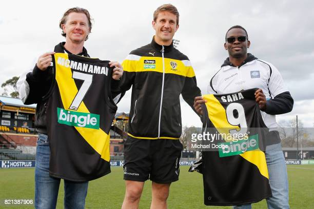 ExLiverpool and Manchester United stars including Steve McManaman and Louis Saha pose with their jumpers after being presented them by Richmond...