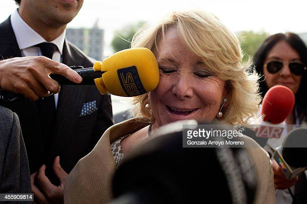 ExMadrid Regional Government President and president of the Popular Party in the region Esperanza Aguirre is hit by a microphone as she arrives at...