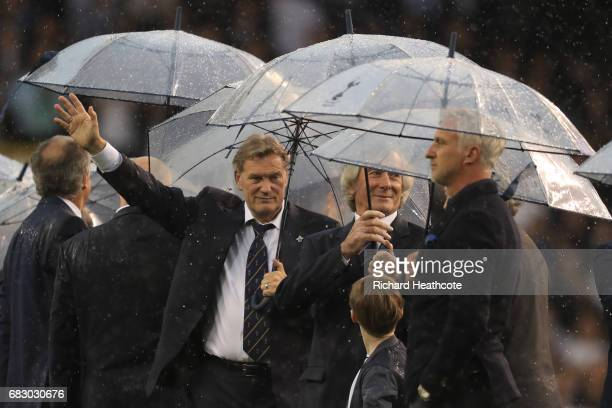 Exmanager and player Glenn Hoddle salutes the crowd alongside Pat Jennings and David Ginola during the closing ceremony after the Premier League...