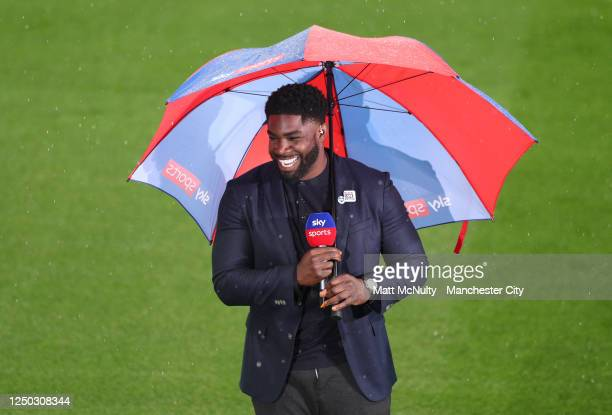 Ex-Manchester City player Micah Richards is seen presenting on TV for Sky Sports prior to the Premier League match between Manchester City and...