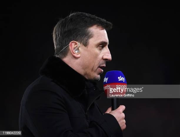 ExManchester United and England footballer turned Sky Television Presenter Gary Neville talks to camera during the Premier League match between...